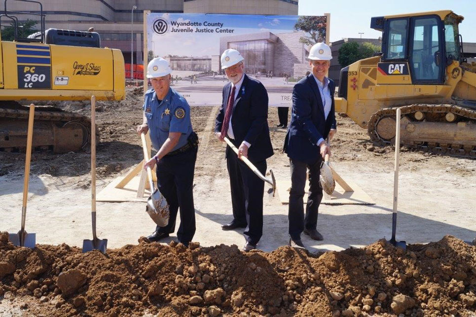 groundbreaking of juvenile justice center construction site with team members holding shovels
